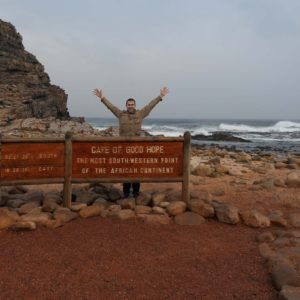 Andrew strikes a victory pose after a tough drive to this spot in South Africa