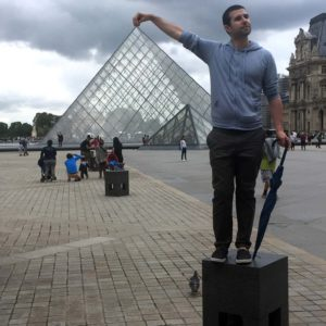 Andrew making jokes outside of the Louvre Museum in Paris