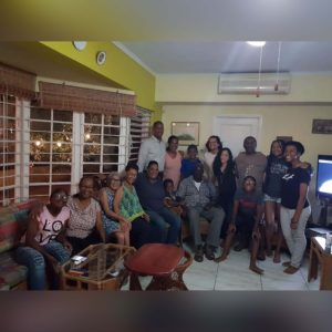 Tiana's family gathering at her aunt's house in Kingston, Jamaica