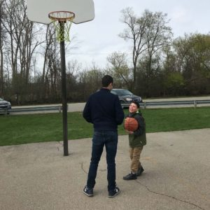 Andrew and his son Santino share a laugh on the court