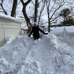 Tiana managed to get on top of the huge snow pile in our driveway this winter