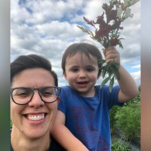 Sami and his mama picking flowers
