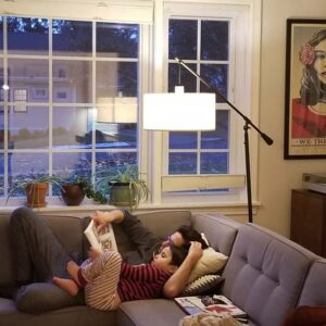 Katya and Sami have quiet time in the living room