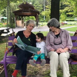 """Grandma Lois, Sami, and """"Mima"""" at the Children's Garden in Ithaca, NY"""