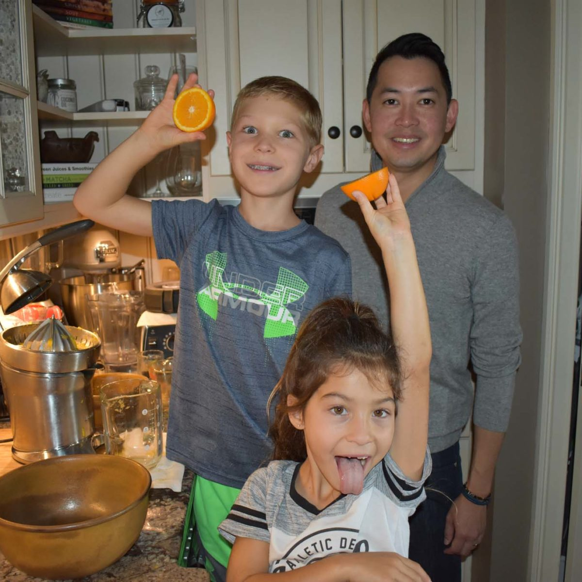Dirk excited for freshly squeezed orange juice with our friends' son and daughter