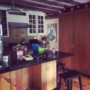 Alannah working on a project in the kitchen. Our kitchen is a natural gathering spot for everyone