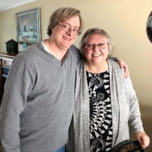 Sarah's stepfather Dave and her mom Debby. They are both excited to become grandparents through adoption!