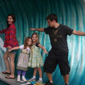 """Chris' sister Cassidy and his brother Dylan """"catching a wave"""" with Alannah and Raya on a trip to Disney"""