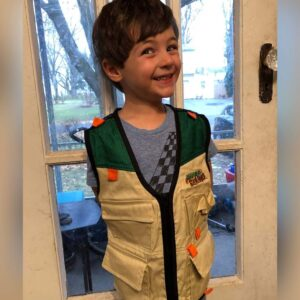 Trying on the fishing vest he got for his birthday