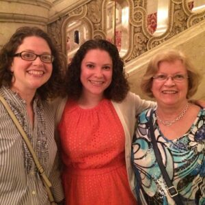 Christine, her sister Beth, and their mom at a concert in Boston, MA