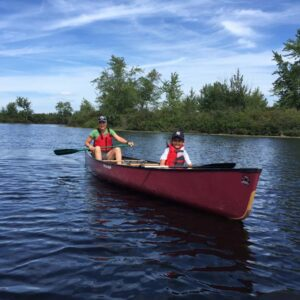 Paddling easy with nephew Raul near Tupper Lake, in upstate New York