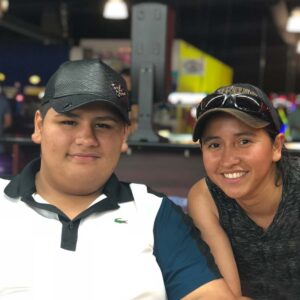 Bowling is one of Cindy's favorite indoor sports because she gets to spend time with nephew Luis