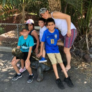 Stopping for a quick break in the shade with Tina's spirit animal, the turtle and nephews Raul, Danny and Raphael and niece Alyson at the Brownsville Zoo in Texas