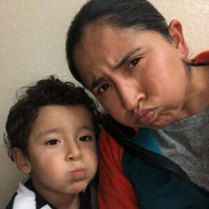 Funny faces pass the time while hanging out with our friends' son, Angel in the little town of Artesia, NM