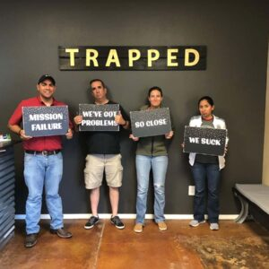 Disappointed after almost conquering an escape room with friends Victor and Armando in Lubbock, TX