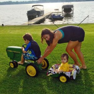 Lake time! Elizabeth takes her role as aunt very seriously — even when it means pushing a heavy tractor around the yard