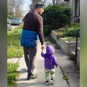 Doug and his niece looking for bunny rabbits on a walk