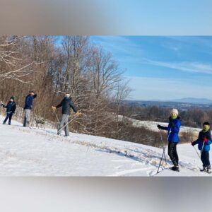 Vermont winters are beautiful too. Here, we're cross-country skiing with friends and their kids
