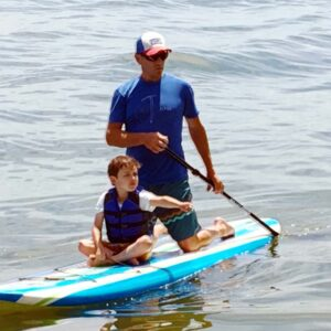 Doug and our nephew on the paddle board, searching for fish
