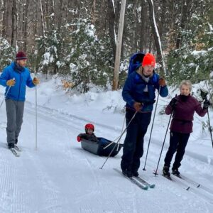 Doug, his brother, mom, and nephew skiing in New Hampshire