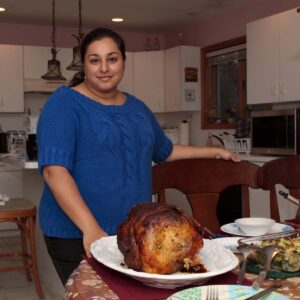 Samina preparing a Thanksgiving feast at her parents' house in Upstate NY