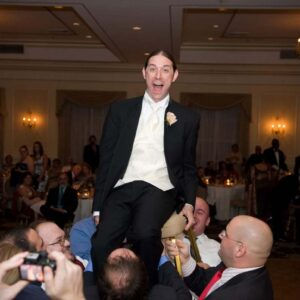 Our close friends dancing the Horah (Chair Dance) at our wedding