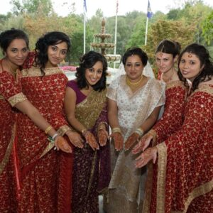 Showing off mehendi designs with Samina's sister and bridesmaids during our wedding
