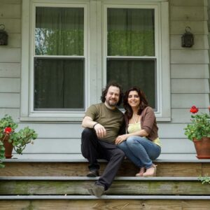 Us on a stoop with beautiful geraniums, one of our favorite flowers