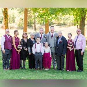 Us the day of our wedding with brother-in-law Adam, Joshua's sister Karissa, Joshua's step-mother Dana, grandmother Helen, nephew Dawson, niece Delaney, grandfather Kenny, sister Haleigh, and Joshua's father Kevin
