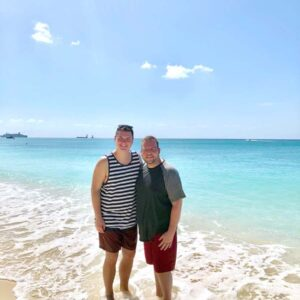 The two of us on our honeymoon at the seven mile beach in the Cayman Islands