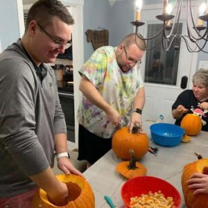 The two of us carving pumpkins with Parker's Aunt Michele in our home!