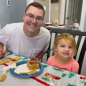 Parker with niece Kenslee, building a ginger bread house