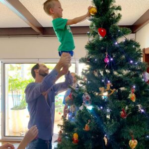 My brother Michael with my nephew Will, decorating the tree